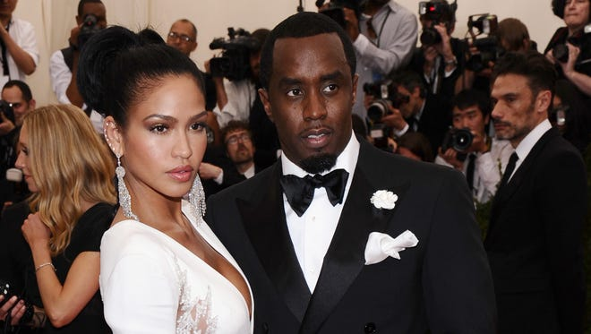 """Cassie, left, and Sean """"Diddy"""" Combs arrive at The Metropolitan Museum of Art's Costume Institute benefit gala celebrating """"China: Through the Looking Glass"""" in New York on May 4, 2015."""