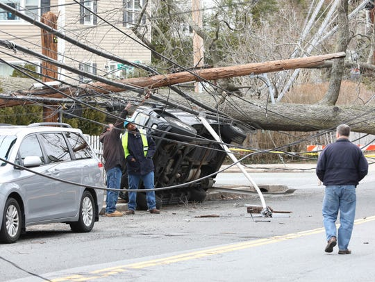 A Con Edison worker and other officials evaluate the