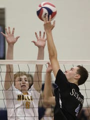 St Xavier's Leo Kastner (4) get the ball past Moeller's