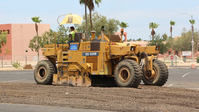 Asphalt was milled and the underlying dirt was moved in Sun City West as construction of Automotive Restoration Club's new facility continues. The building is expected to open at the end of 2015.