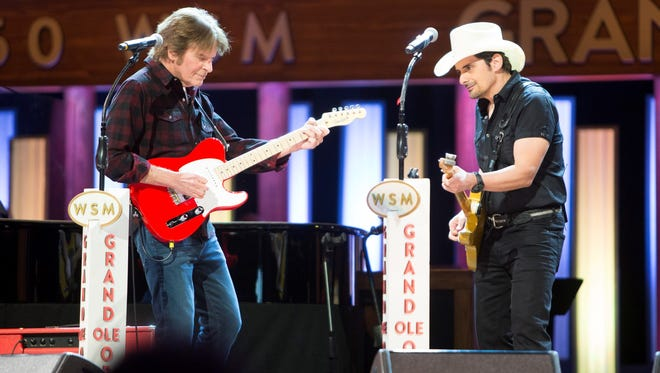 John Fogerty and Brad Paisley perform on The Grand Ole Opry.