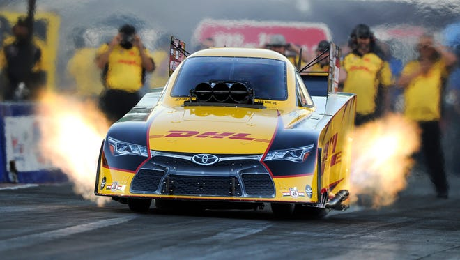 Funny Car driver Del Worsham races at Summit Motorsports Park on Friday