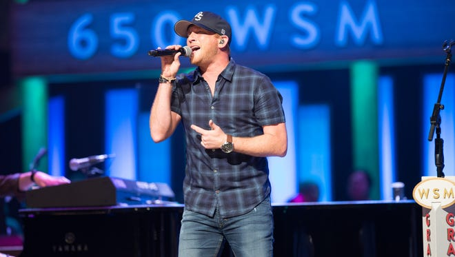 """Cole Swindell performed """"You Should Be Here"""" at the Grand Ole Opry on his father's birthday,"""