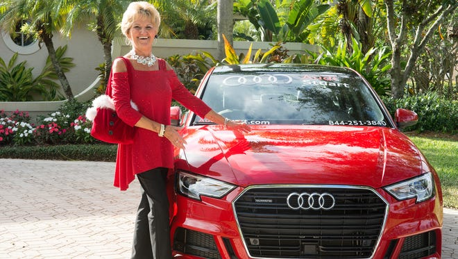 Pam Alverson, pictured with an Audi (Audi was one of the presenting sponsors)