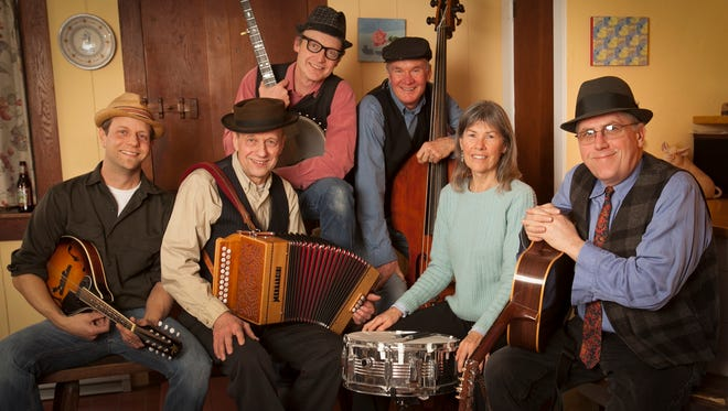 From left, Jason Koski, Richard Koski, Stephan Senders, Harley Campbell, Annie Campbell and Jim Reidy members of TOiVO, will perform Sunday at Trumansburg Conservatory of Fine Arts. Not pictured is the newest member of the group, Paul Martin, who plays guitar.