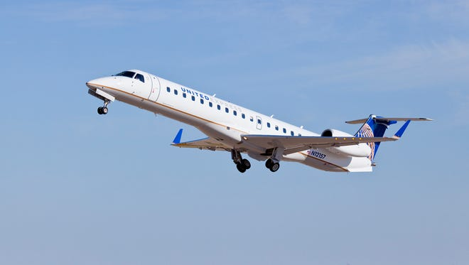 A file photo provided by United shows an Embraer E145 regional jet painted in the United Express colors.