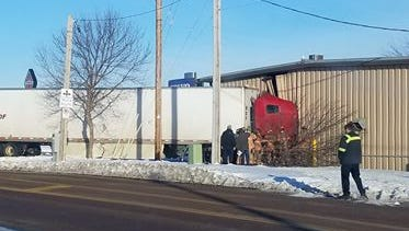 A semi crashed into a building at 54th Street North and Cliff Avenue on Monday morning