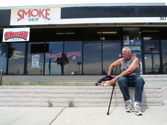 At 11:01 a.m., Steve Wade waits at the Smoke Shop to