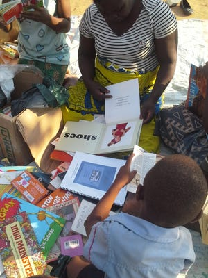 A shipment of books from Lexington arrives in Malawi.
