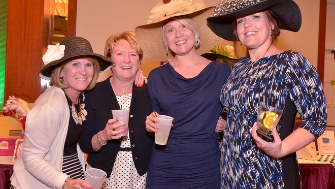 Derby queens (from left) Deb Zevalkink, Linda Molnar, Kristen Thomas and Amy Colligan in their Derby hats.