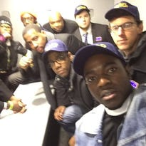 NAACP President and CEO Cornell William Brooks, center, with glasses, with nine others arrested in protests in Chicago Monday following the release of videotape showing the shooting death of 17-year-old Laquan McDonald.