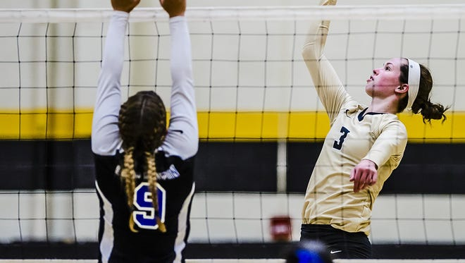 Meredith Norris, 3, of Corunna taps the ball past Allison Petts ,9, of Lake Fenton  in their match Tuesday September 13, 2016 in Corunna.