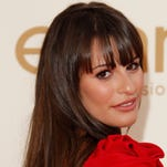 Lea Michele arrives at the 63rd annual Primetime Emmy Awards at the Nokia Theatre.