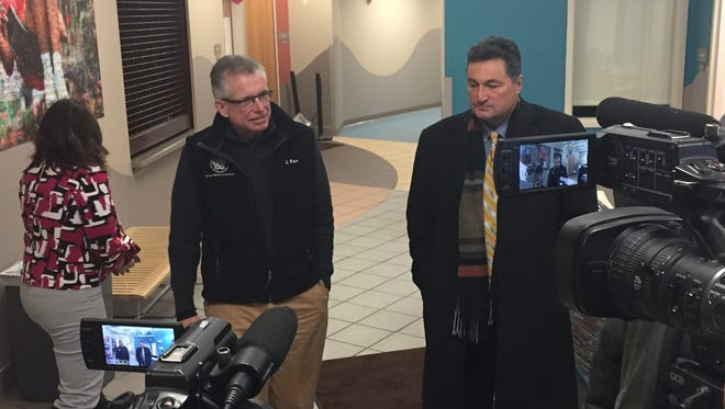 Jim Farr (left) assistant director of Recreation and Mitch Rowe, Director of Buildings and Parks, discussing City's storm recovery efforts at Gantt Recreation Center on March 10, 2017