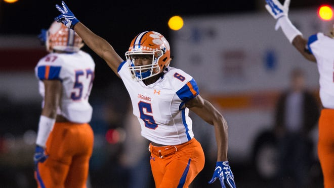 Madison Central's Shacobia Luckett celebrates a fumble recovery during the Madison Central vs Warren Central in Vicksburg.