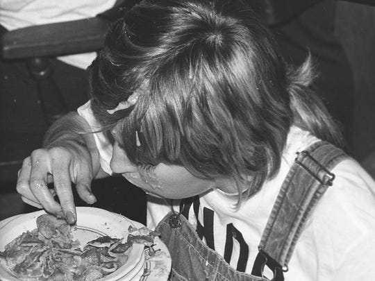 A contestant in a pancake eating contest at the International House of Pancakes in East Lansing, 1973.