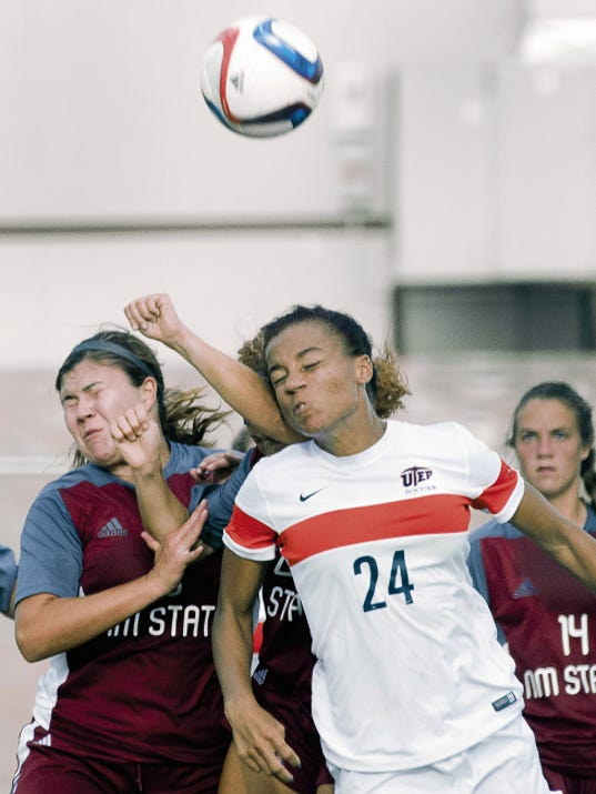 Gary Mook/For the Las Cruces Sun-News   UTEP's Aleah Davis powers through Aggies Audrey Chavez, L, and Mariah Baker to head this coorner kick towards the goal during second half action Wednesday night at the NMSU Soccer Complex. The Miners downed the Aggies 3-1.