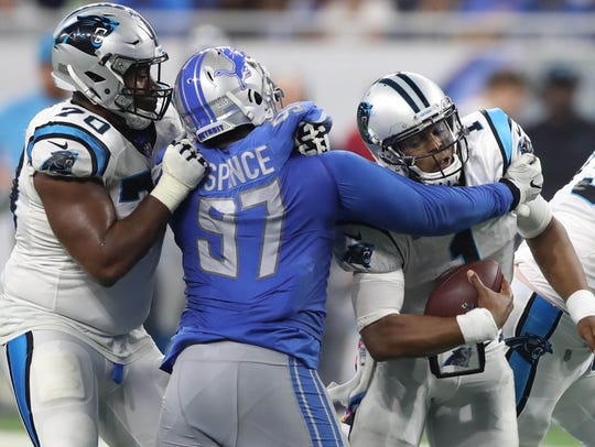 Akeem Spence sacks Cam Newton in the third quarter of the Lions' 27-24 loss to the Panthers at Ford Field on Oct. 8.