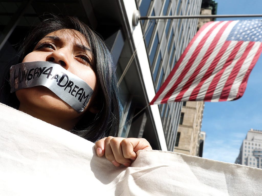 Guadalepe Muller wears tape over mouth while on a hunger strike against the removal of the DREAM Act from the state budget on March 25 in New York. The DREAM act would allow undocumented college students to receive state financial aid and activist ar