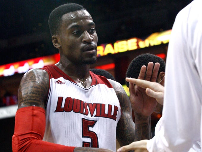 U of L's Kevin Ware returns to the bench after playing for the first time since a season-ending leg injury in March in U of L's game against Pikeville at the KFC Yum! Center. Nov. 6, 2013. Louisville defeated Pikeville 90-61.