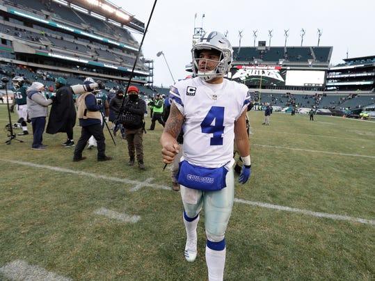 Dallas Cowboys' Dak Prescott walks off the field after an NFL football game against the Philadelphia Eagles, Sunday, Dec. 31, 2017, in Philadelphia. Dallas won 6-0. (AP Photo/Chris Szagola)