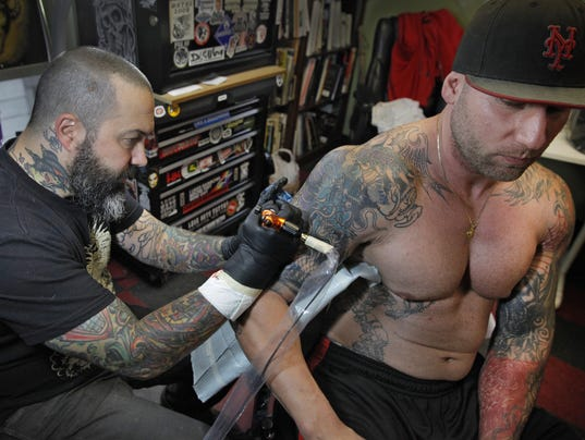 Are tattoo studios 39 artists 39 studios 39 pittsford says no for Tattoo shop rochester ny