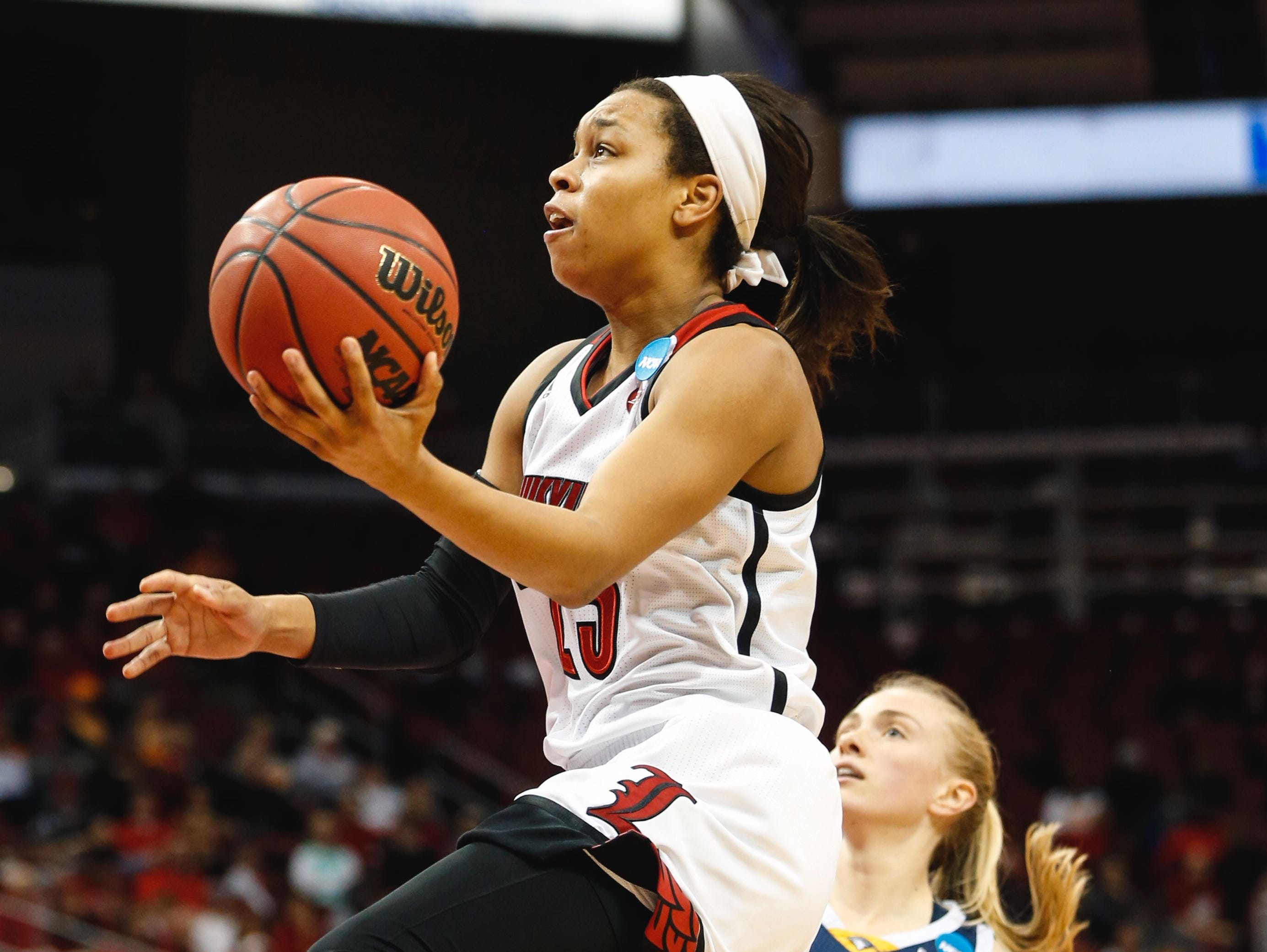 Louisville's Asia Durr drives past Chattanooga's Lakelyn Bouldin to score two of her 27 points during Saturday's game in Louisville.