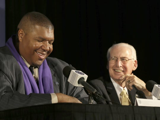 Snyder shares a laugh with former Washington offensive