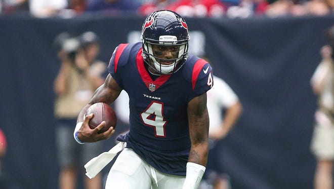 Houston Texans quarterback Deshaun Watson (4) runs with the ball during the first quarter against the Tennessee Titans at NRG Stadium.