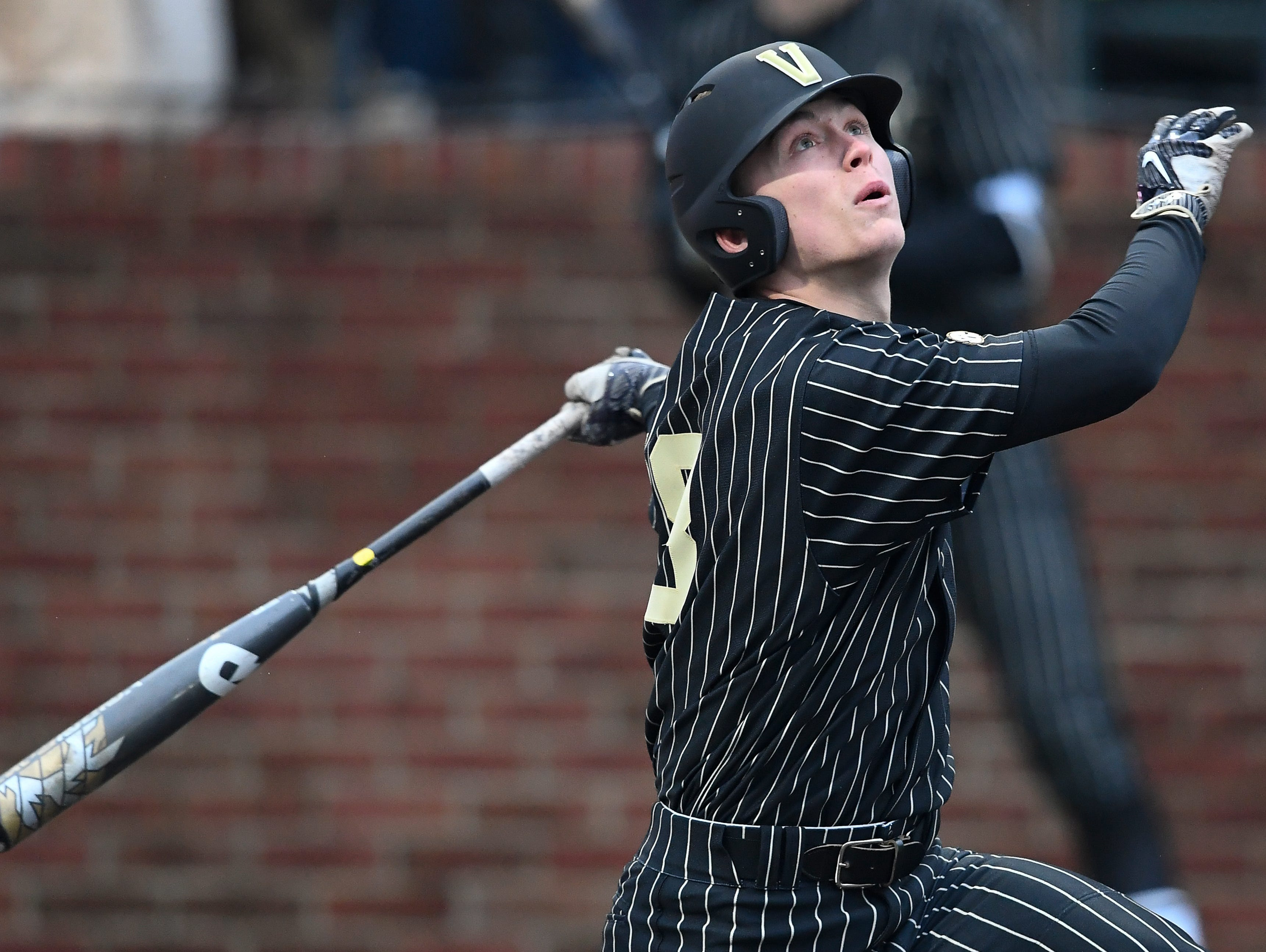 Vanderbilt outfielder Pat DeMarco (18) looks to the sky after hitting the ball during the game against Duke Hawkins Field Friday, Feb. 16, 2018 in Nashville, Tenn.