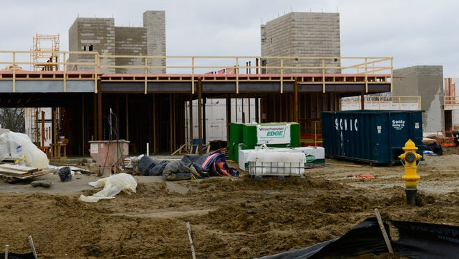 The total projected cost for the Landings at Terra Village, a student housing center at Terra State Community College slated to open in  August, has risen by more than $5 million, from an initial $14.5 million to $19.6 million.