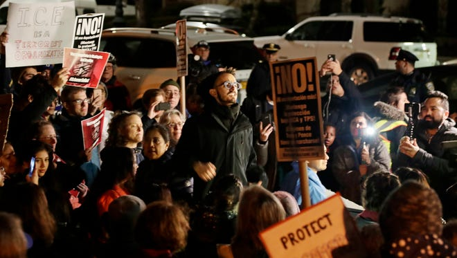 Protestors gather at the home of Sen. Charles Shumer, D-N.Y., on  Tuesday in New York. Schumer faced heated criticism from frustrated liberals who said he caved on Democrats' wish to protect young immigrants from deportation.