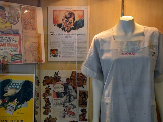 "The Calhoun County Visitors Bureau's new ""The Cereal History Exhibit"" features a variety of curated items, including old uniforms and advertisements from Post Consumer Brands and Kellogg Co."