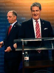 Gubernatorial candidate, state Rep. John Bel Edwards, D-Baton Rouge, left, walks past U.S. Sen. David Vitter, R-La., as they take their places before a debate, sponsored by WDSU television, at their studio in New Orleans, Thursday, Oct. 1, 2015. (AP Photo/Gerald Herbert)