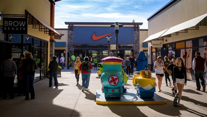 Customers check out the stores during the opening of the Outlets of Des Moines in Altoona, Friday, Oct. 20, 2017.