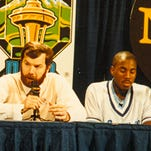Former Seton Hall coach P.J. Carlesimo (left) talks during a press conference in 1989, as John Morton (center) listens.