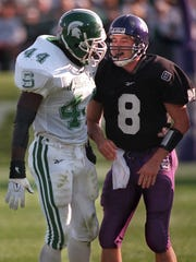 Spartan linebacker Ike Reese, left, has a chat with Northwestern quarterback Tim Hughes, while helping him back on his feet after a hit.