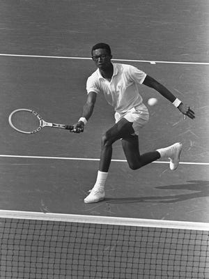 Arthur Ashe displays some of the talent that swept him to the first U.S. Open Tennis Championship in New York on Sept. 9, 1968. His Arthur Ashe Learning Center continues to promote education and tennis around the world.