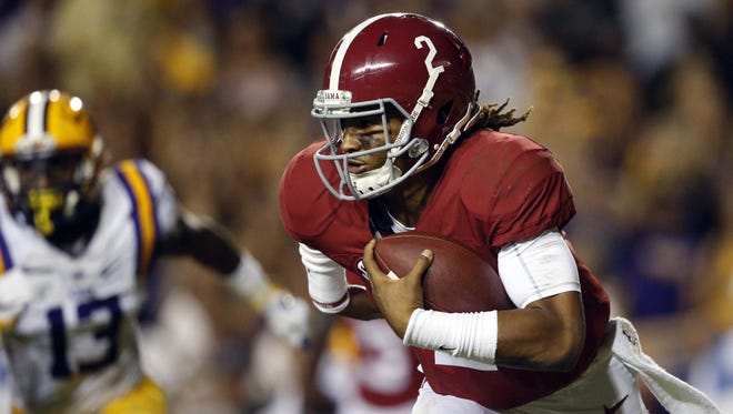 Alabama quarterback Jalen Hurts (2) carries in the first half of an NCAA college football game against LSU in Baton Rouge, La., Saturday, Nov. 5, 2016. (AP Photo/Gerald Herbert)