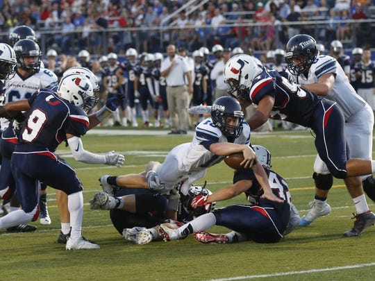 Lewis Central's Max Duggan dives for a first down during
