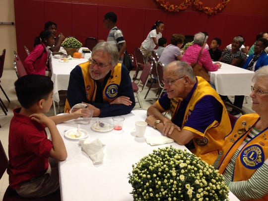 Members of the Lions Club enjoy gumbo and conversation at a Pineville Youth Center event Thursday.
