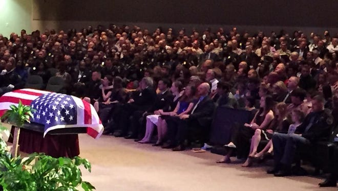 Thousands gather at Temple Baptist Church to attend funeral services for slain Hattiesburg police officer Benjamin Deen.