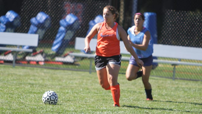 Briarcliff's Jackie Contento controls the ball, with Lexi Grasso looking on, during a morning pre-season practice session at Briarcliff High School on August 26, 2015.