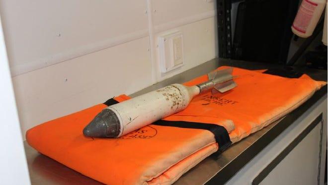 The Ashland County Bomb Squad collected the device found in a shed at 41 Rowland Ave. Thursday and removed it from the premises. The mortar round was found to be a luminary shell used to light up a battle field and did not contain explosives, according to Mansfield police.