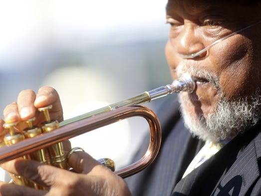 Marcus Belgrave plays the trumpet at the funeral of