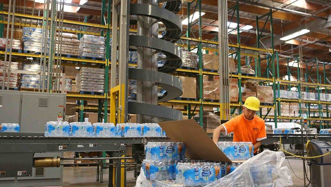 A worker packages bottled water at Nestle Waters North America's plant in Ontario.