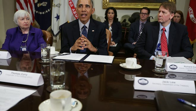 File photo taken in 2016 shows President Obama  President Barack Obama with federal regulators, including Federal Reserve Chair Janet Yellen (Lt) and  Director of the Consumer Financial Protection Bureau Richard Cordray (R).