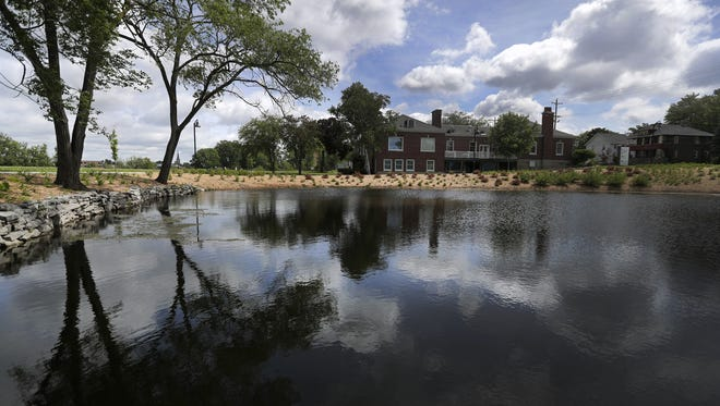 Menasha's regulations don't require a fence around the former Gilbert Paper duck pond on Ahnaip Street.