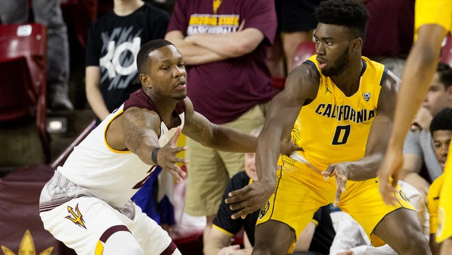 California forward Jaylen Brown passes the ball around Arizona State forward Willie Atwood during a men's basketball game at Wells Fargo Arena in Tempe on March 5, 2016.