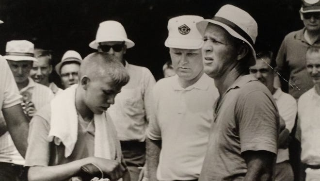 Arnold Palmer shot 66 in '64 at Evansville Country Club. Pictured here during that round are, from left to right, caddie Larry Mackey, Jerry Schreiber and Arnold Palmer.